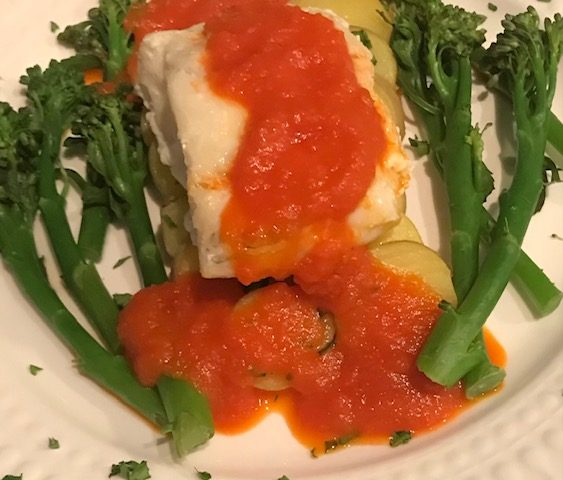 Cod with a Tomato and Red Pepper Sauce on a Bed of Parslied New Potatoes (serves 4)